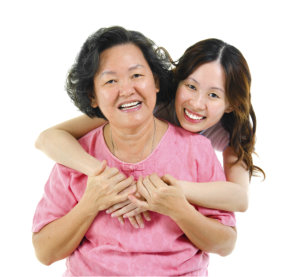 caregiver hugging elderly patient