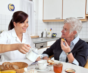 caregiver assisting patient in eating her meals